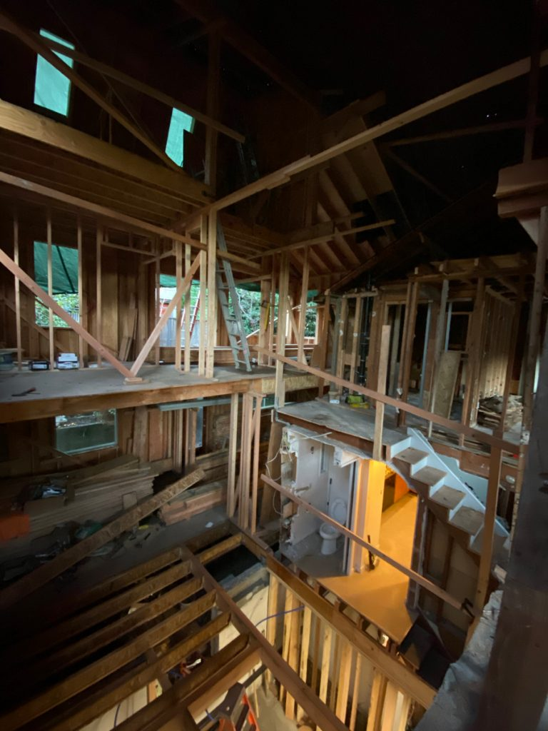 As they continue to frame the remodel, portions of the old house are removed to make way for the new.
