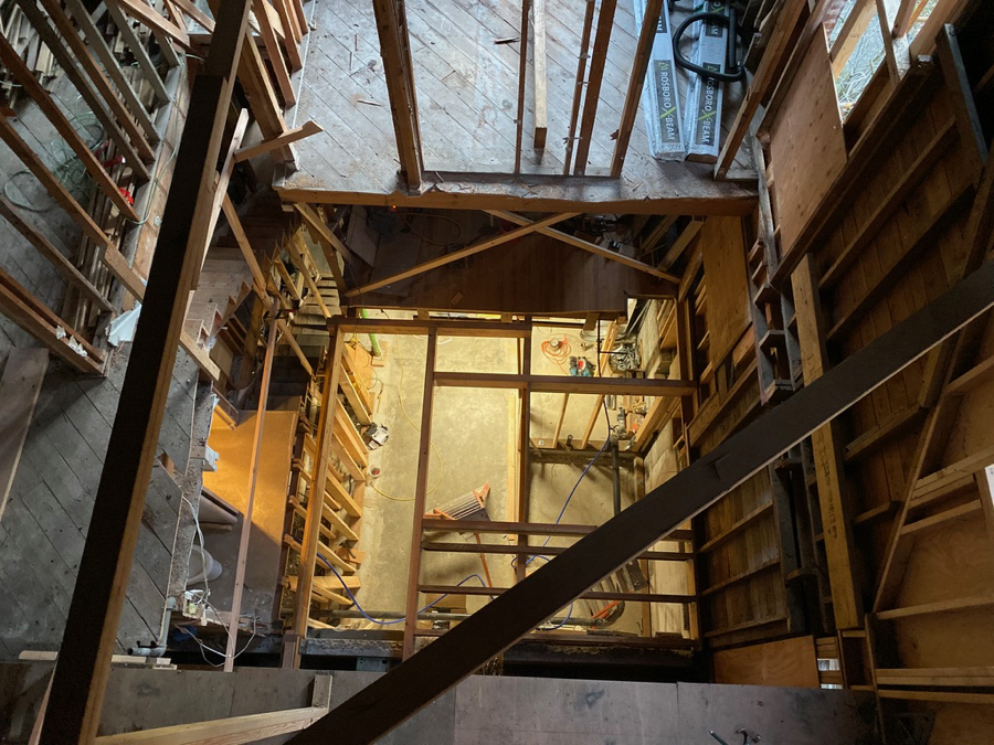 Here we look down where the old floors have been removed. The elevator will be located in a portion of this opening.