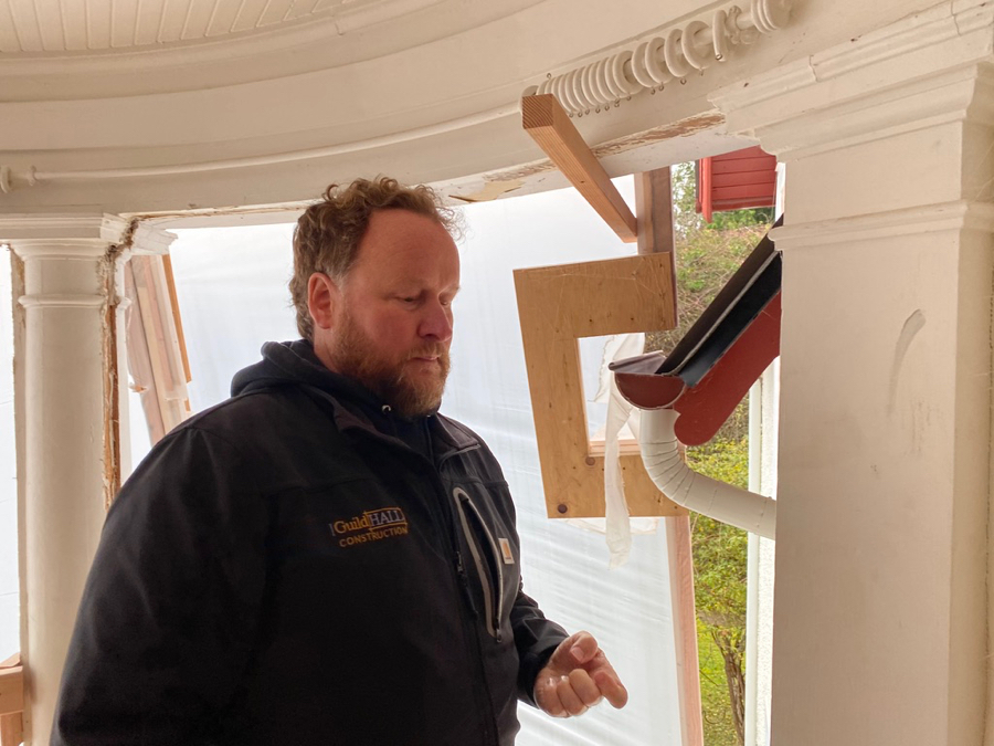 Here the contractor, David Hall with Guild Hall Construction, calls attention to the eave construction and water proofing as we prepare to re-enclose the sun room.